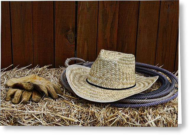 Working Cowboy Photographs Greeting Cards - Straw Hat  on  Hay Greeting Card by Paul Ward
