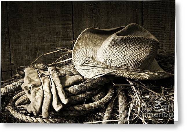 Straw Hat With Gloves On A Bale Of Hay Greeting Card by Sandra Cunningham