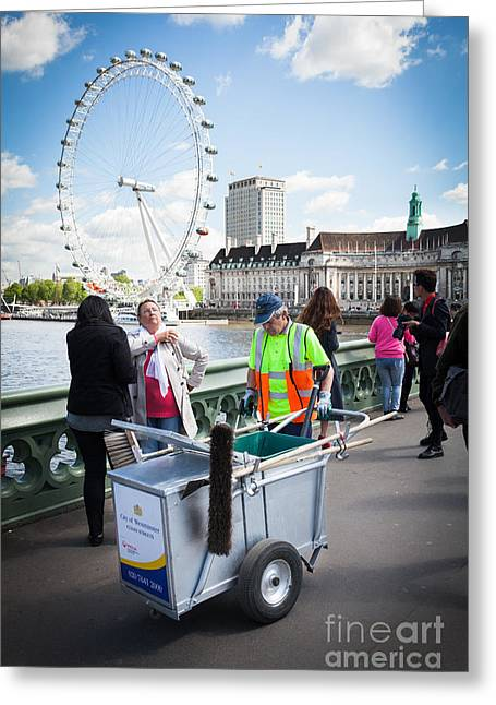 Street Sweeper Greeting Cards - Street cleaner with cart amongst tourists with London Eye. Greeting Card by Peter Noyce