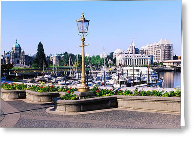 British Columbia Greeting Cards - Street Lamps With Parliament Building Greeting Card by Panoramic Images
