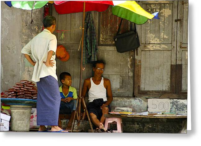 Street Seller Sitting In The Shade Under An Umbrella Yangon Myanmar Greeting Card by Ralph A  Ledergerber-Photography