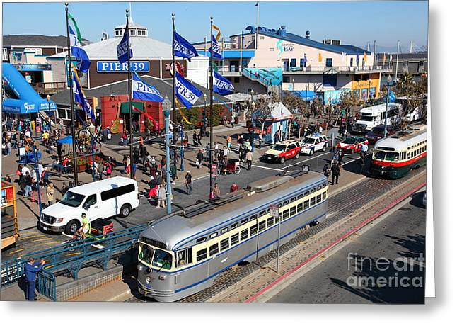 Sight Seeing San Francisco Greeting Cards - Streetcars At Pier 39 San Francisco California 5D26055 Greeting Card by Wingsdomain Art and Photography