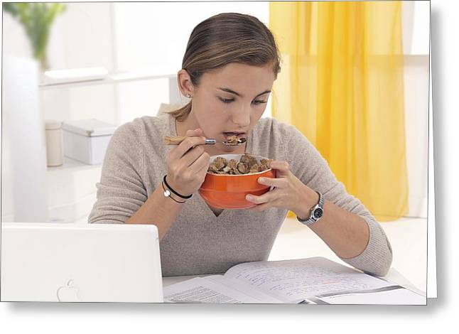 Written French Greeting Cards - Student eating cereal Greeting Card by Science Photo Library