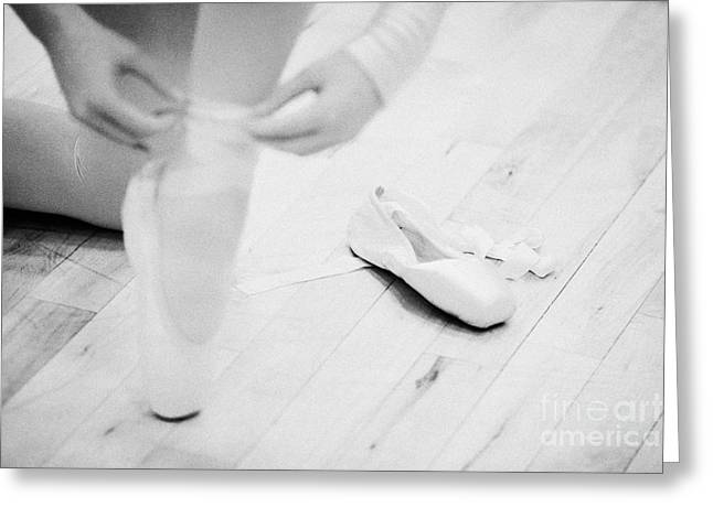 Tying Shoe Greeting Cards - Student Putting On Pointe Shoes At A Ballet School In The Uk Greeting Card by Joe Fox