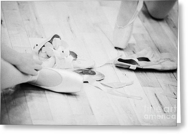 Tying Shoe Greeting Cards - Students Putting On Pointe Shoes At A Ballet School In The Uk Greeting Card by Joe Fox