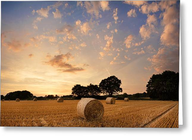 Colorful Cloud Formations Greeting Cards - Stunning Summer landscape of hay bales in field at sunset Greeting Card by Matthew Gibson