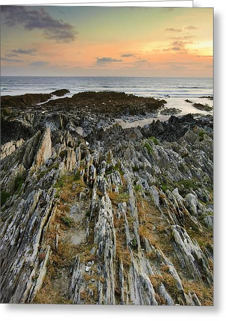 Colorful Cloud Formations Greeting Cards - Stunning vibrant rock formation against ocean and beautiful suns Greeting Card by Matthew Gibson