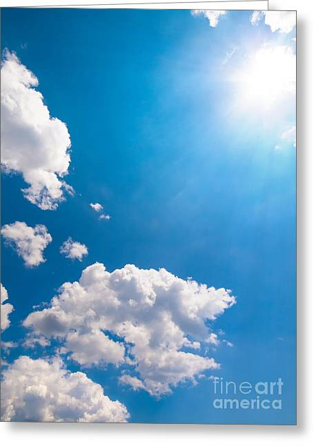 High Noon Greeting Cards - Sun Burst On A Blue Sky And Clouds Greeting Card by Leyla Ismet