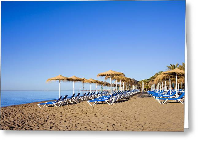 Lounger Greeting Cards - Sun Loungers on a Beach in Marbella Greeting Card by Artur Bogacki