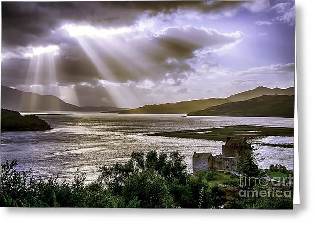 Sun Rays Over Eilean Donan Castle Greeting Card by Chris Thaxter
