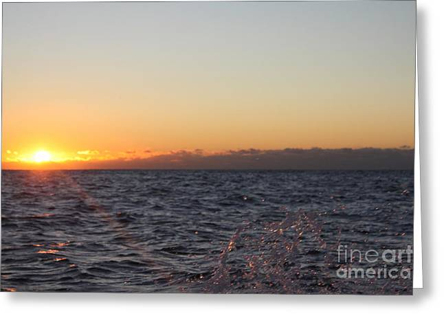 Sun Rising Through Clouds In Rough Waters Greeting Card by John Telfer