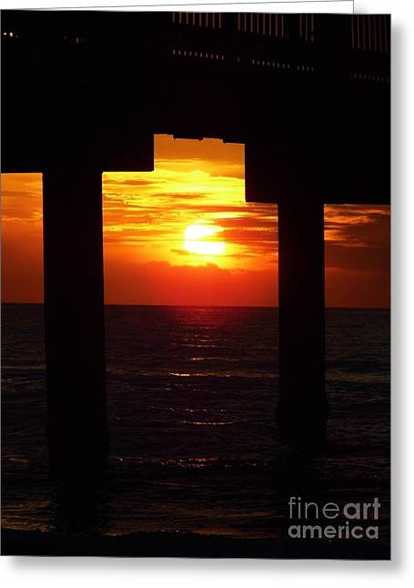 Reflection Of Sun In Clouds Greeting Cards - Sun Setting At The Pier Greeting Card by D Hackett