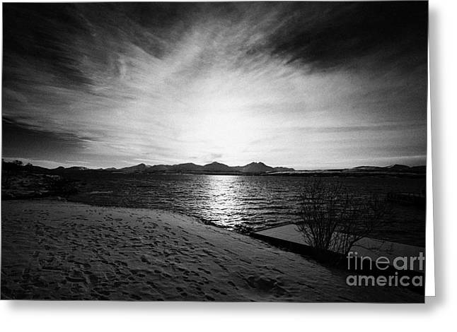 sun setting with halo over snow covered telegrafbukta beach Tromso troms Norway europe Greeting Card by Joe Fox