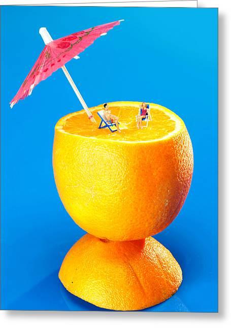 Creative People Greeting Cards - Sunbathers On Orange Little People On Food  Greeting Card by Paul Ge