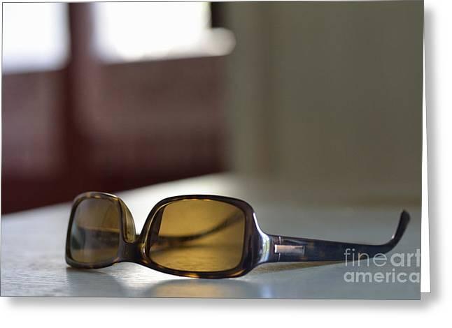 Sunglasses On Table Greeting Card by Sami Sarkis