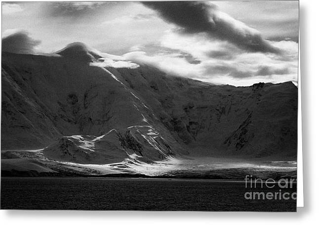 Snow-covered Landscape Greeting Cards - sunlight breaking through clouds on snow covered landscape of anvers island and neumayer channel Ant Greeting Card by Joe Fox
