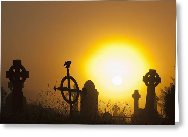 Headstones Greeting Cards - Sunrise At Aghadoe Heights Graveyard Greeting Card by Peter Zoeller