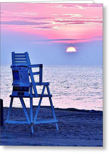 Seacape Greeting Cards - Sunrise Lifeguard Chair Greeting Card by Kim Bemis