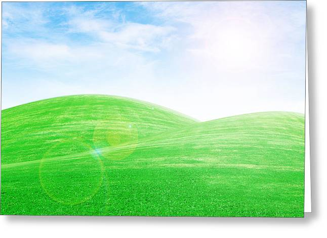 sunrise over green grass hills Greeting Card by Thanapol Kuptanisakorn