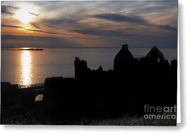 Dunce Greeting Cards - Sunset and silhouette of Dunluce Castle Greeting Card by Alan Campbell