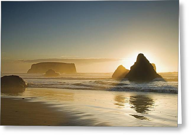Sunset Behind Offshore Rocks Bandon Greeting Card by Philippe Widling