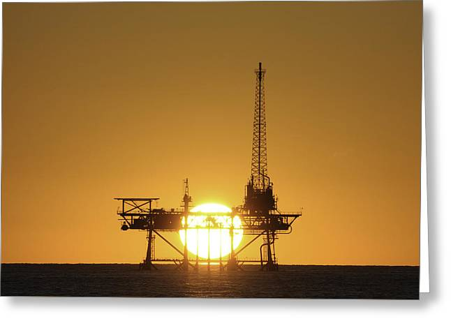 Sea Platform Greeting Cards - Sunset behind oil rig Greeting Card by Bradford Martin