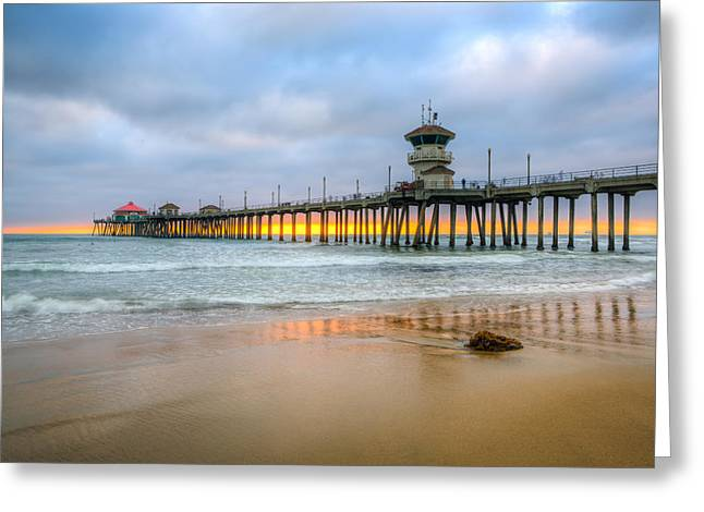 Sunset Drifting Under The Pier Greeting Card by Andrew Slater