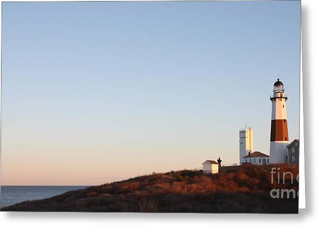 Sunset Over Montauk Lighthouse Greeting Card by John Telfer
