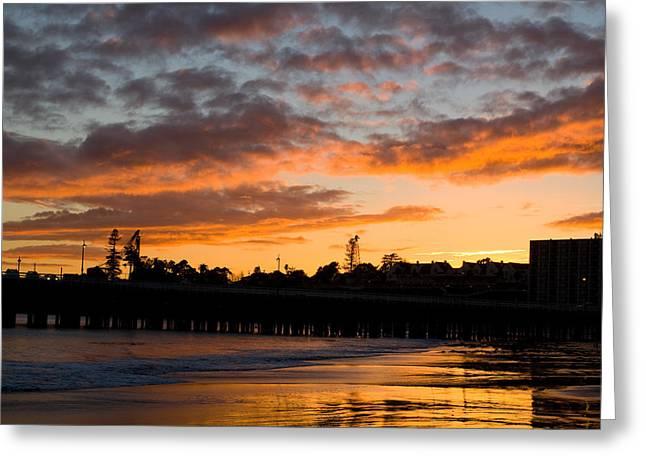 Santa Cruz Art Greeting Cards - Sunset over the Peir Sata Cruz beach  Greeting Card by Kevin  Bartsch