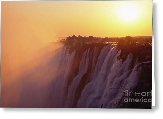 Zambia Waterfall Greeting Cards - Sunset over The Victoria Falls Greeting Card by Alex Cassels