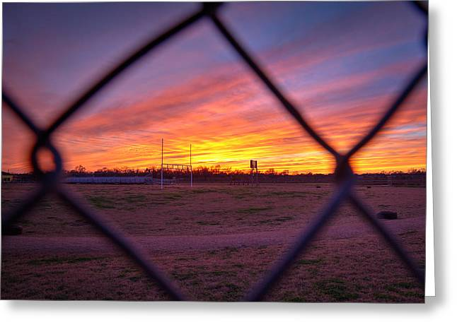 Sunset Through The Fence Greeting Card by Tim Stanley