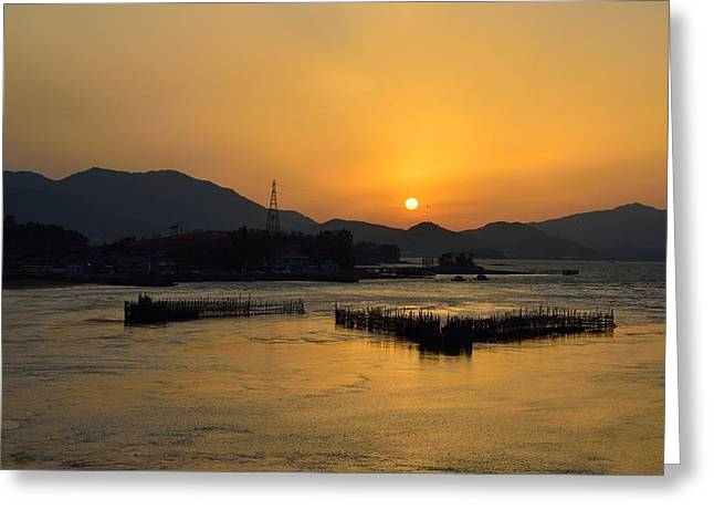 Bamboo Fence Greeting Cards - Sunset with facility for Fishing anchovy by flow of sea water Greeting Card by Sihyeon Park
