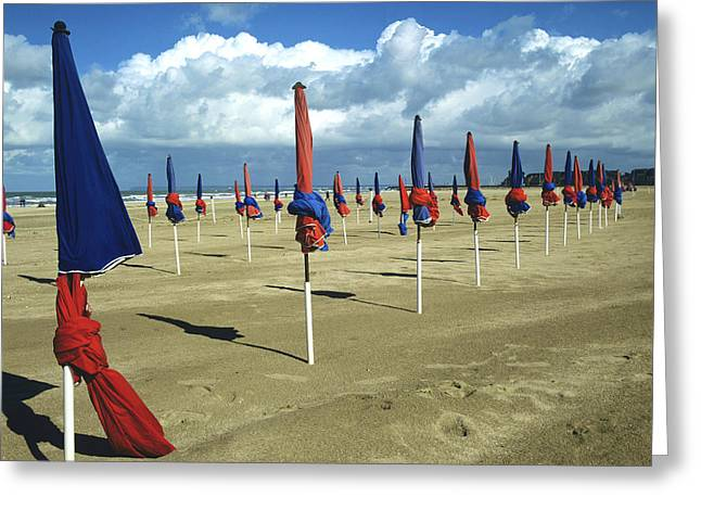 Off Season Greeting Cards - Sunshades on the beach. Deauville. Normandy. France. Europe Greeting Card by Bernard Jaubert