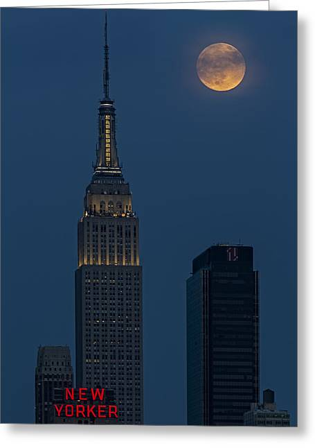 Full Moon Greeting Cards - Super Moon By The Empire State Building NYC Greeting Card by Susan Candelario