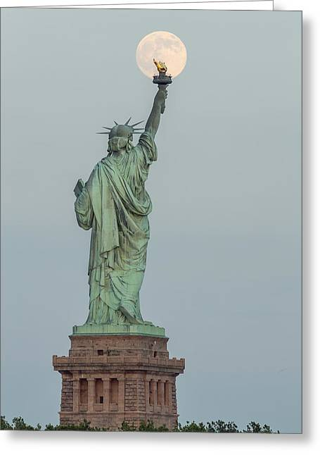 Full Moon Greeting Cards - Super Moon Rises Over The Statue Of Liberty Greeting Card by Susan Candelario