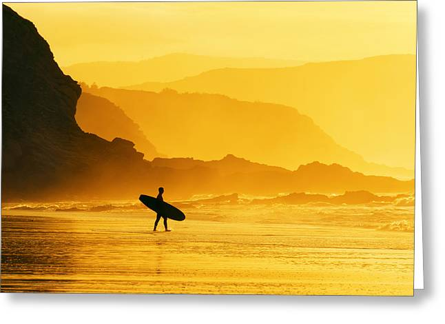 Pais Vasco Greeting Cards - Surfer Entering Water At Misty Sunset Greeting Card by Mikel Martinez de Osaba
