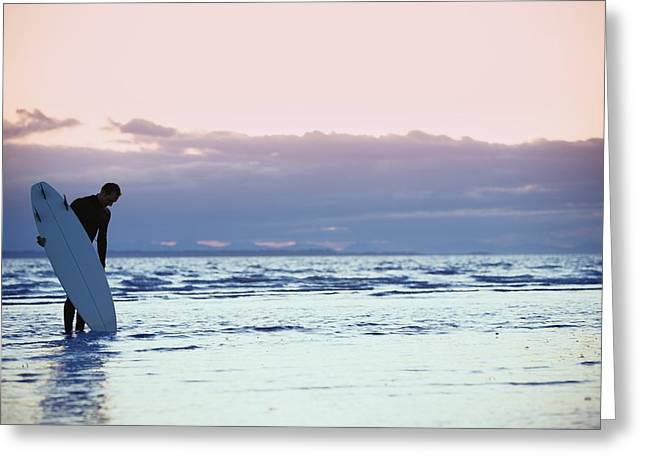 Surfer In The Shallow Water Greeting Card by Daniel Sicolo