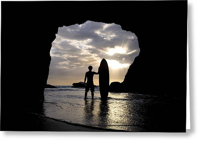 Reflections Of Sun In Water Greeting Cards - Surfer Inside A Cave At Muriwai New Greeting Card by Deddeda