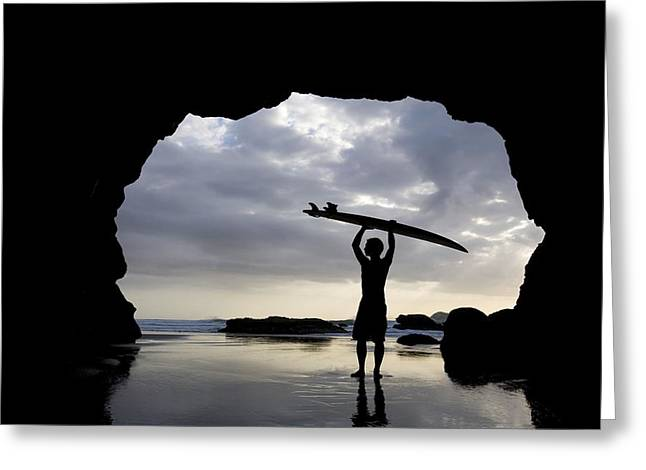 Surf Silhouette Greeting Cards - Surfer Inside A Cave At Muriwai North Greeting Card by Deddeda