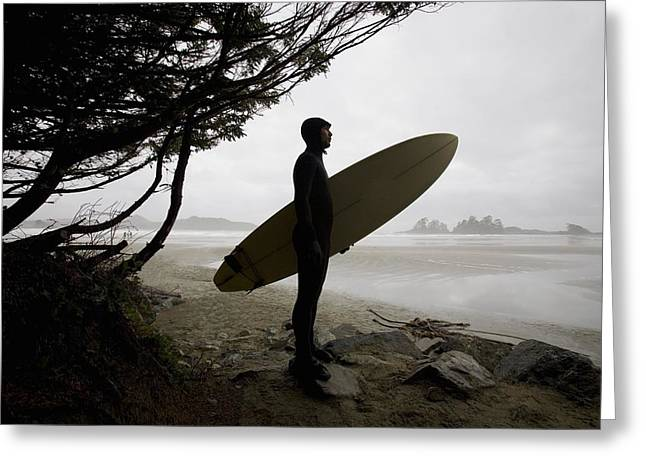 Surf Silhouette Greeting Cards - Surfer Observing Water From The Beach Greeting Card by Deddeda
