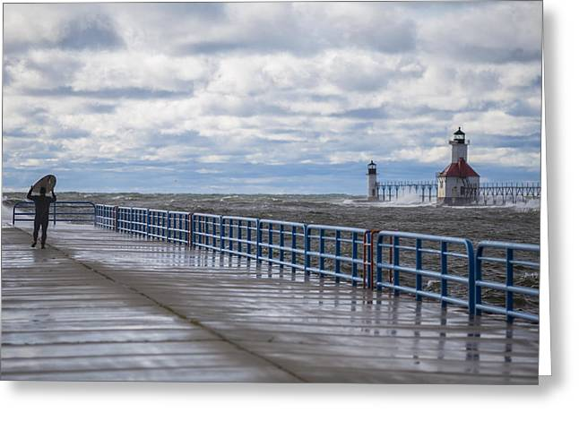 Pure Michigan Greeting Cards - Surfer on pier by ST Joe Lighthouse  Greeting Card by John McGraw