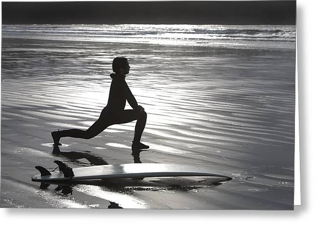 Surf Silhouette Greeting Cards - Surfer Stretching On Beach Greeting Card by Deddeda