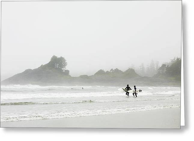 Surf Silhouette Greeting Cards - Surfers Walking On The Beach In Cox Bay Greeting Card by Ian Grant