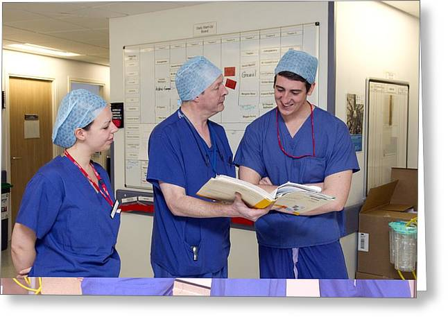 Discussing Photographs Greeting Cards - Surgeons discussing patient notes Greeting Card by Science Photo Library