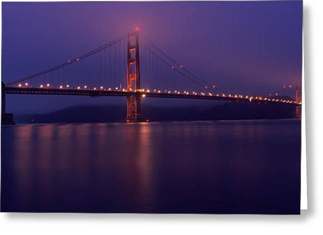 Sky Transportation Greeting Cards - Suspension Bridge Lit Up At Dawn Viewed Greeting Card by Panoramic Images