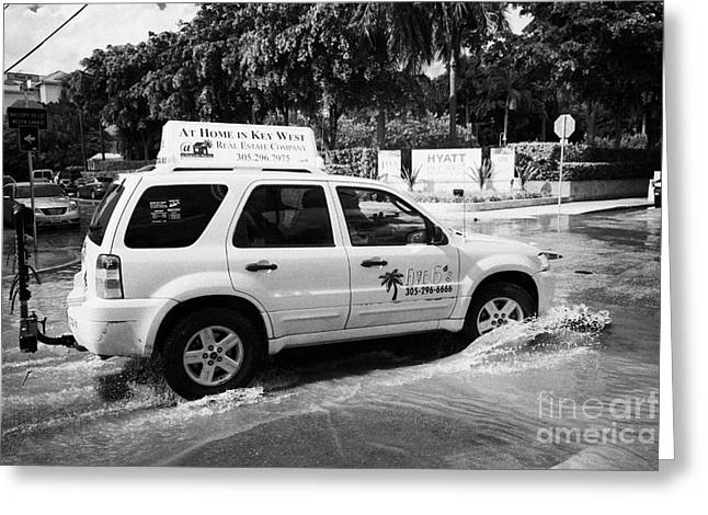 Flooding Greeting Cards - Suv Driving Through Streets Flooded By Heavy Rainfall Key West Florida Usa Greeting Card by Joe Fox