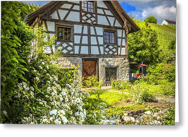 Swiss Chalet in the Garden Greeting Card by Debra and Dave Vanderlaan