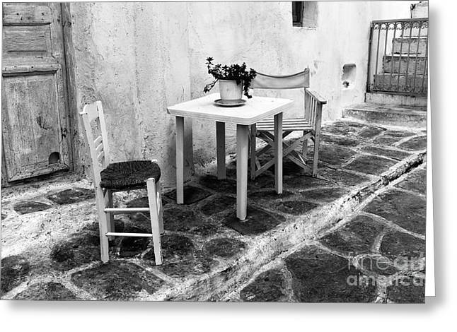 Table And Chairs Greeting Cards - Table for Two in Mykonos Town mono Greeting Card by John Rizzuto