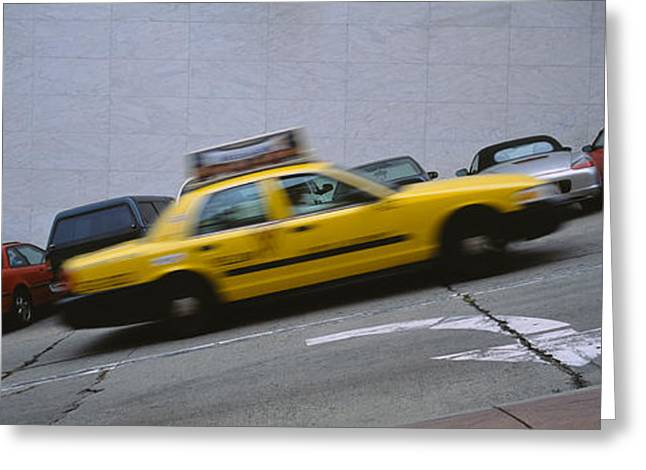 The Hills Greeting Cards - Taxi Running On The Road, San Greeting Card by Panoramic Images