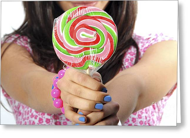 Adolescence Greeting Cards - Teen offers lollipop to viewer Greeting Card by Doron Magali